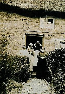 The Hunt family outside 2 Church Cottages, circa 1905. Photo: David Humphriss